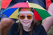 Light rain brings out various waterproofing options - The 2017 Latitude Festival, Henham Park. Suffolk 15 July 2017