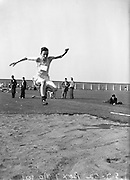 05/07/1952<br /> 07/05/1952<br /> 05 July 1952<br /> N.A.C.A. (National Athletic and Cycling Association) Championship of Ireland Finals at Iveagh Grounds, Crumlin, Dublin. R. O'Dwyer (Kerry) winning the Hop, Step and Jump competition.