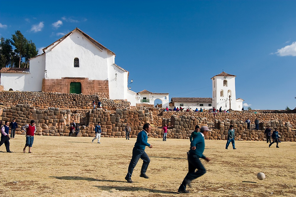 Local men play a casual game of soccer among the Inca ruins at Chinchero, Peru, following the weekly town meeting.