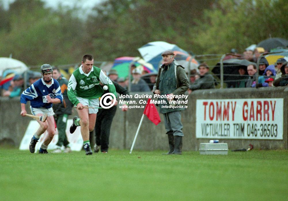 27-10-1996. Rathmolyon v Kilmessan - Meath SHC Final 1996.<br /> Martin Smith solos for for  Rathmolyon.<br /> Photo: John Quirke / www.quirke.ie<br /> ©John Quirke Photography, 16 Proudstown Road, Navan. Co. Meath. (info@quirke.ie / 046-9028461 / 087-2579454).