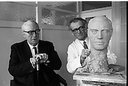 Sculptor Seamus Murphy at work. Murphy has been commissioned by the staff of the New Ireland Assurance Company to make a bronze bust of Dr. M.W. O'Reilly, Chairman and Managing Director of the company. The bust will be presented to Dr. O'Reilly to mark the Golden Jubilee of the New Ireland Assurance Company. Picture shows Dr. O'Reilly sitting for Seamus Murphy at the company offices on Dawson Street..31.01.1968