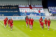 Barnsley players warming-up before the EFL Sky Bet Championship match between Queens Park Rangers and Barnsley at the Kiyan Prince Foundation Stadium, London, England on 20 June 2020.