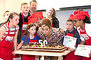 Hare Majesteit Koningin Maxima opent de 50e Resto VanHarte in Lelystad. Dit is een KinderResto. Kinderen in de leeftijd van 8 tot en met 13 jaar kunnen hier samenkomen om te koken en te leren over voeding, bewegen en samenwerken. <br /> <br /> Her Majesty Queen Maxima opens the 50th Resto VanHarte in Lelystad. This is a KinderResto. Children ages 8 to 13 can meet here to cook and learn about nutrition, moving and working together.<br /> <br /> Op de foto / On the photo:  Koningin Maxima blaast samen met de kinderen de kaarjes uit ///Queen Maxima blows the candles together with the children