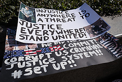 © Licensed to London News Pictures. 02/04/2016. London, UK. Placards are left in front of the US Embassy in London during a protest to call for the release of Steven Avery and Brendan Dassey, both jailed in connection with the 2005 murder of Teresa Halbach in Wisconsin, USA. The case was brought to prominence by the hit Netflix series 'Making a Murderer', which suggests the possibility of foul play in the arrest and convictions of the two men. Photo credit : Rob Pinney/LNP