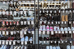 Racks of shoes for sale.