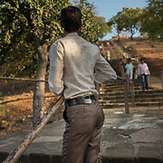 A fashionable indian man with tight pants.