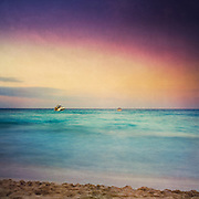 Two boats rocking on the sea - long exposure of 8 s - texturized photograph