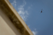 Syrian government helicopters circle over Kureen, a town in Idlib, Syria. The aircraft circle daily over the province, striking often, and at civilian targets with missiles made in Russia. Kureen, Idlib, Syria. 17/06/2012