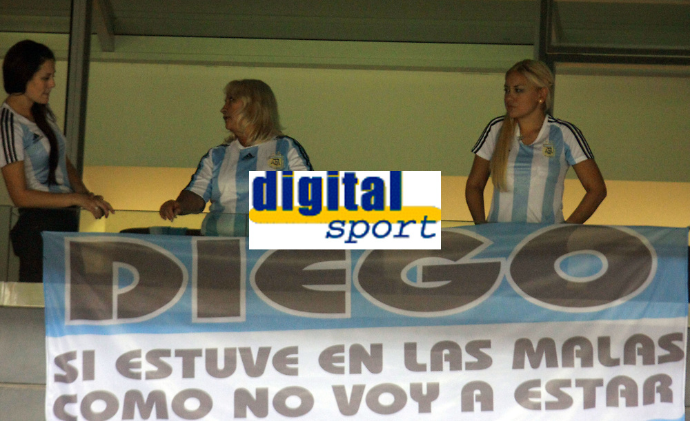 """BUENOS AIRES, ARGENTINA - MARCH 28, 2009.<br /> 2010 FIFA World Cup qualifying Soccer match between ARGENTINA and VENEZUELA in the River Plate Stadium.<br /> Here DIEGO MARADONA girlfriend VERONICA OJEDA with a Pancart """"If I was at the bad moments, how I don't will be Today??""""<br /> © PikoPress"""
