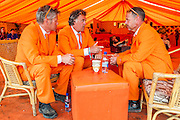 Three Dutchmen, chilling in the morning.  It is all orange in the Beat Hotel. The 2013 Glastonbury Festival, Worthy Farm, Glastonbury. 30 June 2013. © Guy Bell, guy@gbphotos.com, all rights reserved