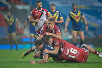 Rugby League - 2020 Coral Challenge Cup - Salford Red Devils vs Warrington Wolves - TW Stadium, St Helen's<br /> <br /> Warrington Wolves's Joe Philbin is tackled <br /> <br /> COLORSPORT/TERRY DONNELLY