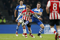 (L-R) Luuk de Jong of PSV, Erik Bakker of PEC Zwolle during the Dutch Eredivisie match between PSV Eindhoven and PEC Zwolle at the Phillips stadium on February 03, 2018 in Eindhoven, The Netherlands
