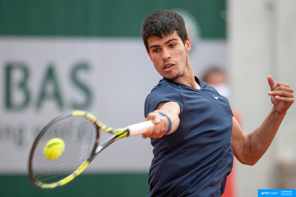 PARIS, FRANCE May 25.  Carlos Alcaraz of Spain in action against Lukas Lacko of Slovakia on the second day of the qualifying tournament at the 2021 French Open Tennis Tournament at Roland Garros on May 25th 2021 in Paris, France. (Photo by Tim Clayton/Corbis via Getty Images)