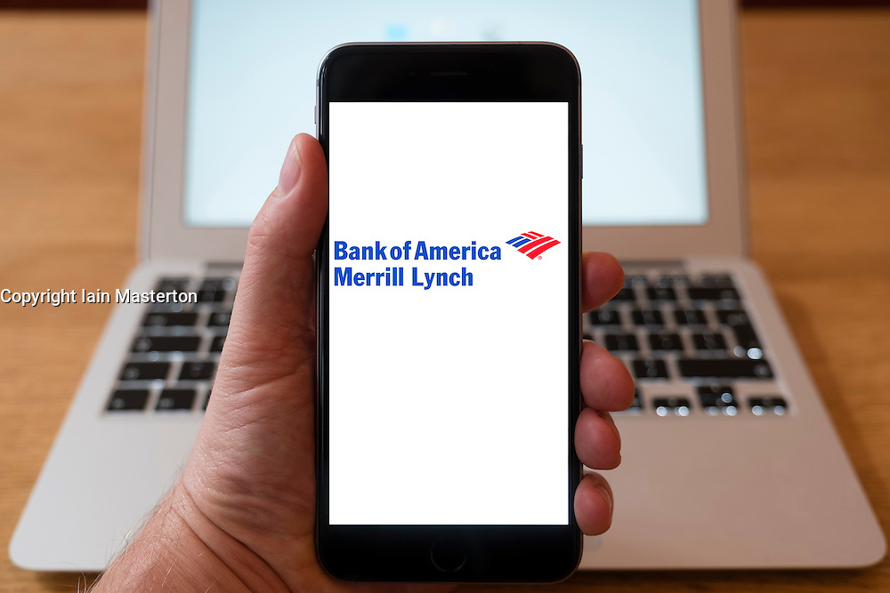 Using iPhone smartphone to display logo of Bank of America Merrill Lynch , the corporate and investment banking division of Bank of America