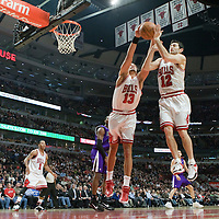 21 December 2009: Chicago Bulls center Joakim Noah and Chicago Bulls guard Kirk Hinrich jump for a rebound during the Sacramento Kings 102-98 victory over the Chicago Bulls at the United Center, in Chicago, Illinois, USA.