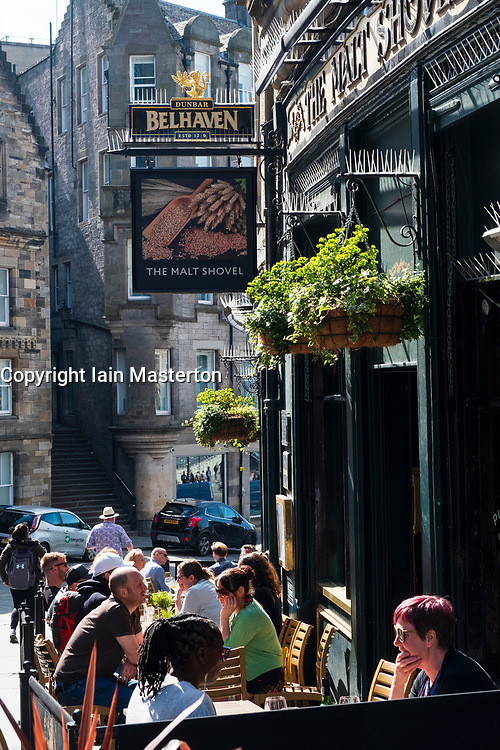 Busy bars on Cockburn Street in Edinburgh Old Town, Scotland, UK