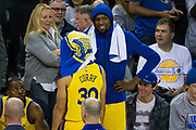 Golden State Warriors forward Kevin Durant (35) and Golden State Warriors guard Stephen Curry (30) hang out during a time out against the Minnesota Timberwolves at Oracle Arena in Oakland, Calif., on January 25, 2018. (Stan Olszewski/Special to S.F. Examiner)