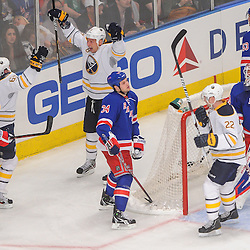 Buffalo Sabres right wing Travis Turnbull (65) celebrates his goal, scored after it deflected off New York Rangers center John Mitchell's (34) skate, with Buffalo Sabres left wing Cody McCormick (8) during second period NHL action between the Buffalo Sabres and the New York Rangers at Madison Square Garden in New York, N.Y. The Sabres defeated the Rangers 4-1.