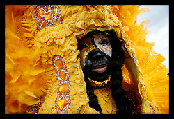 April 29th, 2006. New Orleans, Louisiana. Jazzfest . The New Orleans Jazz and Heritage festival. A Mardi Gras Indian in the crowd.