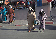 Two women Islamic clothing walking in the street Marrakech, Morocco,