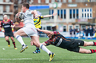 Lloyd Williams  of the Cardiff Blues breaks past the tackle from Adam Warren (R) of the Newport Gwent Dragons. Guinness Pro12 rugby match, Cardiff Blues v Newport Gwent Dragons at the Cardiff Arms Park in Cardiff, South Wales on Sunday 17th April 2016.<br /> pic by Simon Latham, Andrew Orchard sports photography.