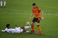 Rafa Mir of Wolverhampton Wanderers is tackled by Leroy Fer of Swansea city (l).  The Emirates FA Cup, 3rd round replay match, Swansea city v Wolverhampton Wanderers at the Liberty Stadium in Swansea, South Wales on Wednesday 17th January 2018.<br /> pic by  Andrew Orchard, Andrew Orchard sports photography.