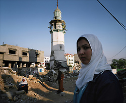 Beit Hanoun residents are seen in front of the Umm al-Nasr Mosque, which was destroyed by Israeli airstrikes, Gaza Strip, Palestinian Territories, Nov. 23, 2006. According to Human Rights Watch, since September 2005, Israel has fired about 15,000 rounds at Gaza while Palestinian militants have fired around 1,700 back.
