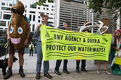London, UK. 5th August, 2021. Extinction Rebellion activists protest outside the Department for Environment, Food and Rural Affairs (Defra) against the pollution of the UK's waterways. The activists were highlighting pollution of rivers by water companies and farms and the failure of the Environment Agency and Defra to protect waterways and to prosecute offenders.