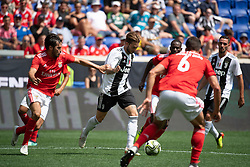July 28, 2018 - Harrison, New Jersey, United States - Juventus forward LUCA CLEMENZA (38) dribbles the ball past SL Benfica defender YURI RIBEIRO (15) and SL Benfica defender RòBEN DIAS (6) during the International Champions Cup at Red Bull Arena in Harrison, NJ.  Juventes defeats SL Benfica 1-1  (Credit Image: © Mark Smith via ZUMA Wire)