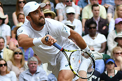 © Licensed to London News Pictures. 07/07/2016. STEVE JOHNSON plays against ROGER FEDERER in a forth round mens singles match on the seventh day of the WIMBLEDON Lawn Tennis Championships.  London, UK. Photo credit: Ray Tang/LNP