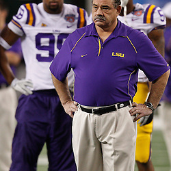 Jan 7, 2011; Arlington, TX, USA; LSU Tigers defensive coordinator John Chavis watches during warm ups prior to kickoff of the 2011 Cotton Bowl against the Texas A&M Aggies at Cowboys Stadium. LSU defeated Texas A&M 41-24.  Mandatory Credit: Derick E. Hingle