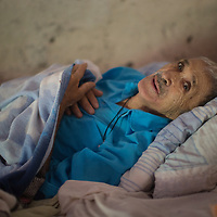 """Jesus Waiting to Die. <br /> <br /> Fausto de Jesús Vásquez, Los Patios, La Paz <br /> <br /> """"I don't remember. Ah, yes, I met my wife, working. She would bring the food to us when we worked in the fields, I saw her, and I fell in love with her. We had two children.<br /> <br /> I was born in Nahuaterique. Nahuaterique was in El Salvador, now it is in Honduras. We have double nationality. (Nahuaterique was part of an international border dispute between El Salvador and Honduras that was resolved by the International Court at the Hague in 1992, passing to Honduran administration)<br /> <br /> I'm dying. I am surrounded by my family. My children live nearby. Here nature is abundant, it's good for maize and beans, coffee, yuca. I worked with vegetables too, tomatos, cucumbers, to sell.<br /> We saw a bit of everything in that time, in the war. We lost everything, the house, all our things, but they are material things, you can get all that again, life is what you can't get back if you lose it, the dead can't do anything. We rebuilt everything after the war."""" <br /> <br /> The health service in Honduras has been affected by large-scale embezzlement by senior government officials including the substitution of medical pharmaceuticals with tablets made of flour.<br /> <br /> Jesus died peacefully at home in April."""