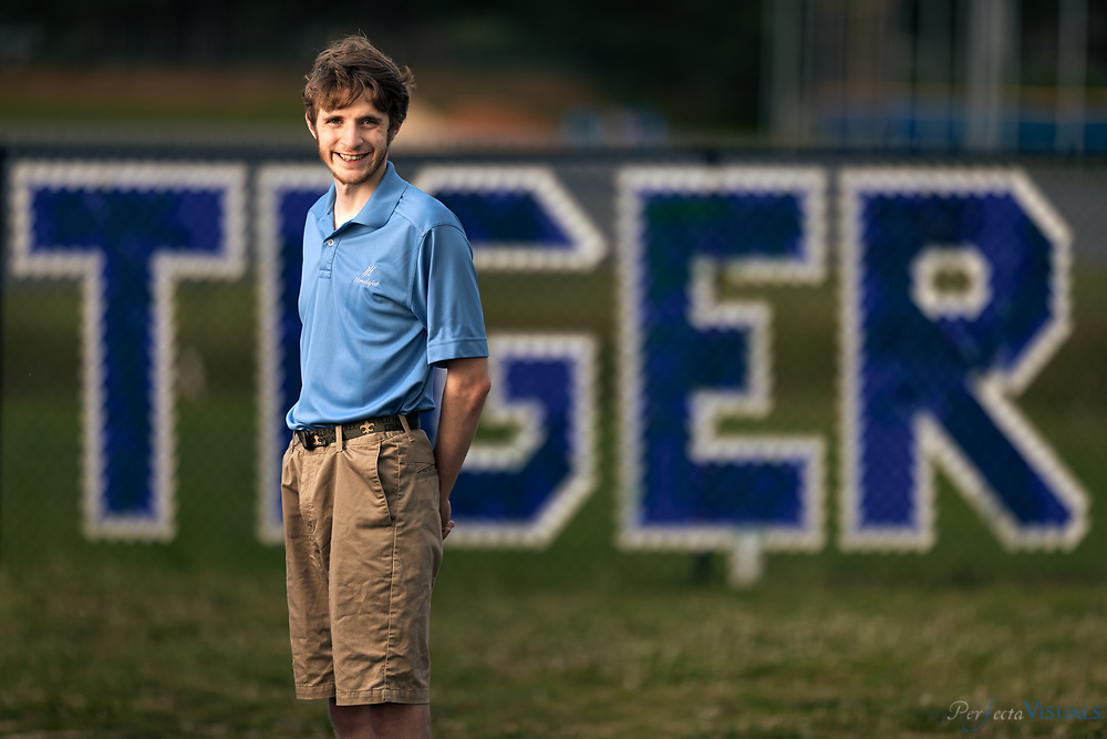 """Ben Foley-Ragsdale High<br /> <br /> Ben Foley on the Ragsdale High School Campus.<br /> <br /> Ben is an Eagle Scout, a medal winner at the Special Olympics in soccer and swimming and a member of the National Honor Society at Ragsdale High. He also has autism. On June 8, he will graduate from Ragsdale and enter GTCC in the fall to study graphic design and computer engineering. Writes Ben:""""Scouting has helped me learn how to be a leader, despite having autism. I am thankful for leaders along the way that have had the patience to work with me and help me overcome my challenges..I expect to use what I have learned from scouting throughout the rest of my life.""""<br /> <br /> Photographed, Monday, May 20, 2019, in Greensboro, N.C. JERRY WOLFORD and SCOTT MUTHERSBAUGH / Perfecta Visuals"""