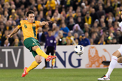 © Licensed to London News Pictures. 11/6/2013. Mark Milligan kicks the ball during the FIFA World Cup Qualifying match between Australia Vs Jordan at Docklands stadium, Melbourne, Australia.. Photo credit : Asanka Brendon Ratnayake/LNP