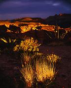 Sunrise light striking the rim of Fish Creek Canyon on a stormy morning, Maricopa County, Tonto National Forest, Arizona.