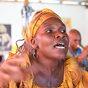 """CAPTION: Rose Marie Etienne sings her heart out. Her song says, """"I'm an adult, but I don't live among people."""" This is a reference to living in slavery, and to the slaves' dehumanization by their masters. However, the ultimate message is one of liberty and independence. ORGANIZATION: Troupe Dahomey / Sant Pont Ayiti (SPA). LOCATION: La Fleur du Chaine, Rue Capois, Port-au-Prince, Haiti. INDIVIDUAL(S) PHOTOGRAPHED: Rose Marie Etienne."""