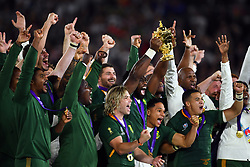 South Africa's Siya Kolisi lifts the William Webb Ellis trophy after their 32-12 victory in the 2019 Rugby World Cup final match against England at Yokohama Stadium.