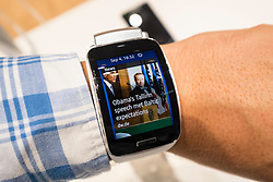 Samsung Gear S smart watch showinging latest news  on display at IFA 2014  consumer electronics show in Berlin Germany
