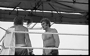 Ali vs Lewis Fight, Croke Park,Dublin.<br /> 1972.<br /> 19.07.1972.<br /> 07.19.1972.<br /> 19th July 1972.<br /> As part of his built up for a World Championship attempt against the current champion, 'Smokin' Joe Frazier,Muhammad Ali fought Al 'Blue' Lewis at Croke Park,Dublin,Ireland. Muhammad Ali won the fight with a TKO when the fight was stopped in the eleventh round.<br /> <br /> Image shows Bugner consoling a well beaten Neilson.