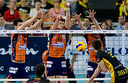 Mariusz Wlazly of Belchatow (R) vs Alen Sket, Matevz Kamnik and Andrej Flajs of ACH at  match for 3rd place of CEV Indesit Champions League FINAL FOUR tournament between PGE Skra Belchatow, POL and ACH Volley Bled, SLO on May 2, 2010, at Arena Atlas, Lodz, Poland.  (Photo by Vid Ponikvar / Sportida)