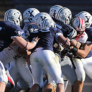 John Spooney, Brown, is tackled by the Yale defense during the Yale V Brown, Ivy League Football match at Yale Bowl. Yale won the match 24-17. New Haven, Connecticut, USA. 9th November 2013. Photo Tim Clayton