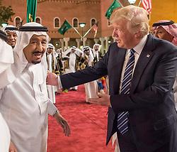 Saudi King Salman Bin Abdelaziz (or Abdul Aziz) Al Saud (L) dances the 'ardha' or traditional sword dance with US President Donald Trump in Riyadh, Saudi Arabia on May 20, 2017. This is the first US president's visit abroad. Photo by Balkis Press/ABACAPRESS.COM