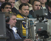 Twickenham, England, Autumn International. RFU Twickenham Stadium<br /> 16/11/2002<br /> International Rugby - England vs Australia.<br /> Australain team manager Eddie Jones watches the match on the TV cameras screen.         [Mandatory Credit:Peter SPURRIER/Intersport Images]
