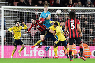 Emiliano Martinez (26) of Arsenal tries get to the ball over Adam Smith (15) of AFC Bournemouth during the The FA Cup match between Bournemouth and Arsenal at the Vitality Stadium, Bournemouth, England on 27 January 2020.