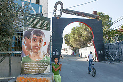 A view of a sculpture of a key over a gate to the Aida refugee camp in Bethlehem. The key symbolises the refugees' right to return to the homes that they fled in 1967. From a series of photos commissioned by  British NGO, Medical Aid for Palestinians (MAP).