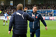 AFC Wimbledon manager Neal Ardley and Bristol Rovers manager Darrell Clarke go to shake hands before the EFL Sky Bet League 1 match between Bristol Rovers and AFC Wimbledon at the Memorial Stadium, Bristol, England on 18 November 2017. Photo by Graham Hunt.