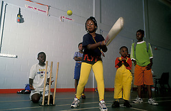 Young people playing cricket at Broadwater Farm Community Centre; London Borough of Haringey UK