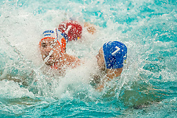 Jorn Winkelhorst of the Netherlands in action against Gabriel DragomirescuVlad, Florin TicMarius of Romania during the Olympic qualifying tournament. The Dutch water polo players are on the hunt for a starting ticket for the Olympic Games on February 16, 2021 in Rotterdam