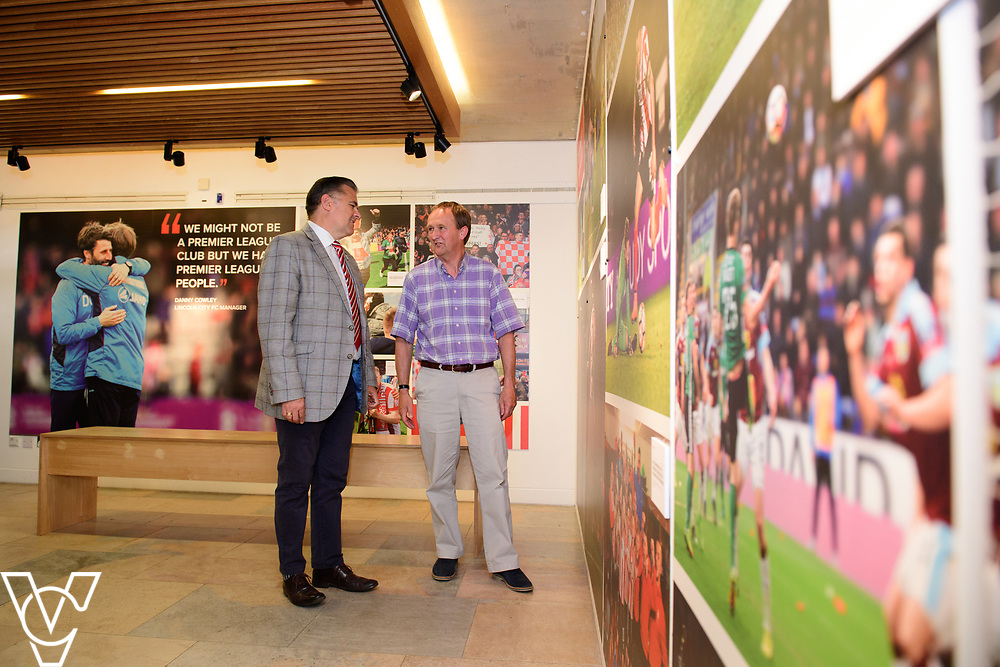 A special exhibition has launched at The Collection museum, in Lincoln. 'The Journey - a Celebration of Lincoln City FC 2016-18' celebrates two historic seasons for the Imps.  Pictured is, from left, Lincoln City director Kevin Cook and Councillor Nick Worth, executive member for culture at Lincolnshire County Council.<br /> <br /> Picture: Chris Vaughan Photography<br /> Date: June 22, 2108