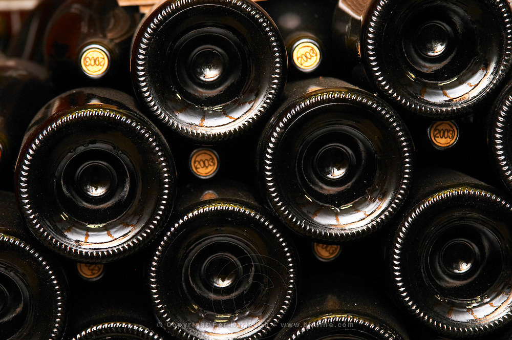 Bottles stacked alternating with corks stamped with the vintage 2003. Domaine Eric et Joel Joël Durand, Ardeche, Ardèche, France, Europe